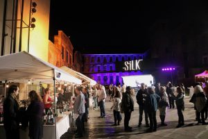 People at event at night time at silk mill enjoying our stage lighting services